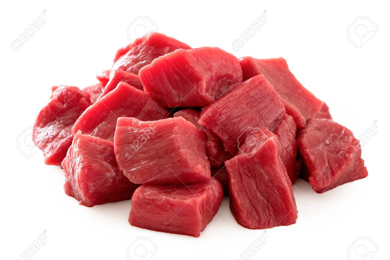 Pile of beef cubes isolated on white. - 127357185