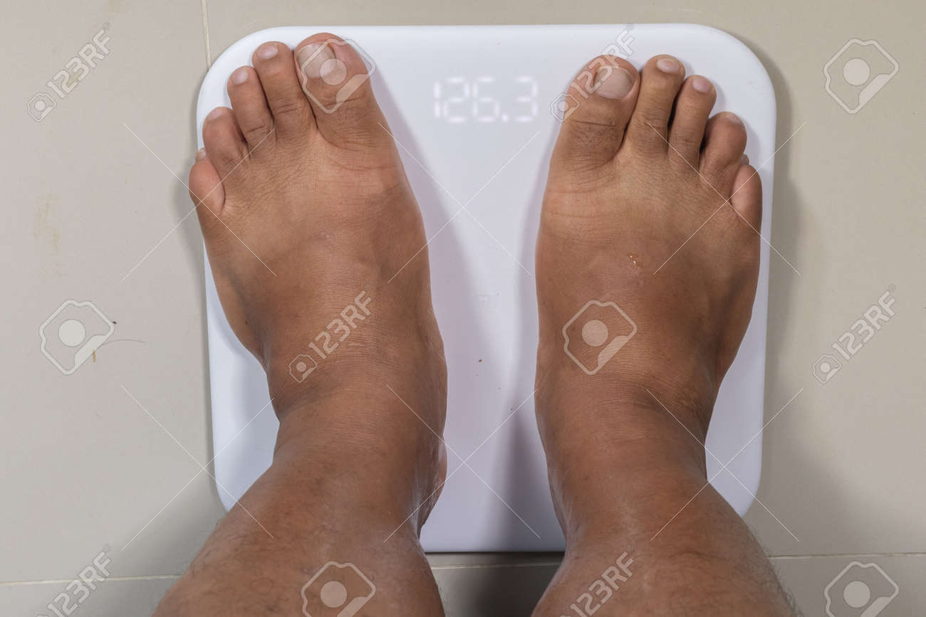 close up of man feet and digital smart scale - 126953205