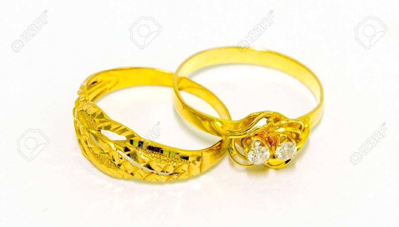 Geliebte Ein Paar Goldene Hochzeit Ringe Auf Weißem Hintergrund Lizenzfreie &QE_49