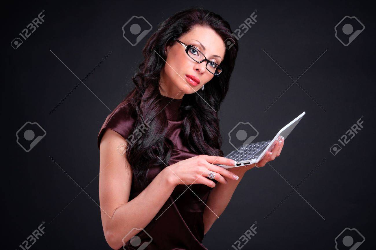 Business woman with a computer in hands Stock Photo - 8444149