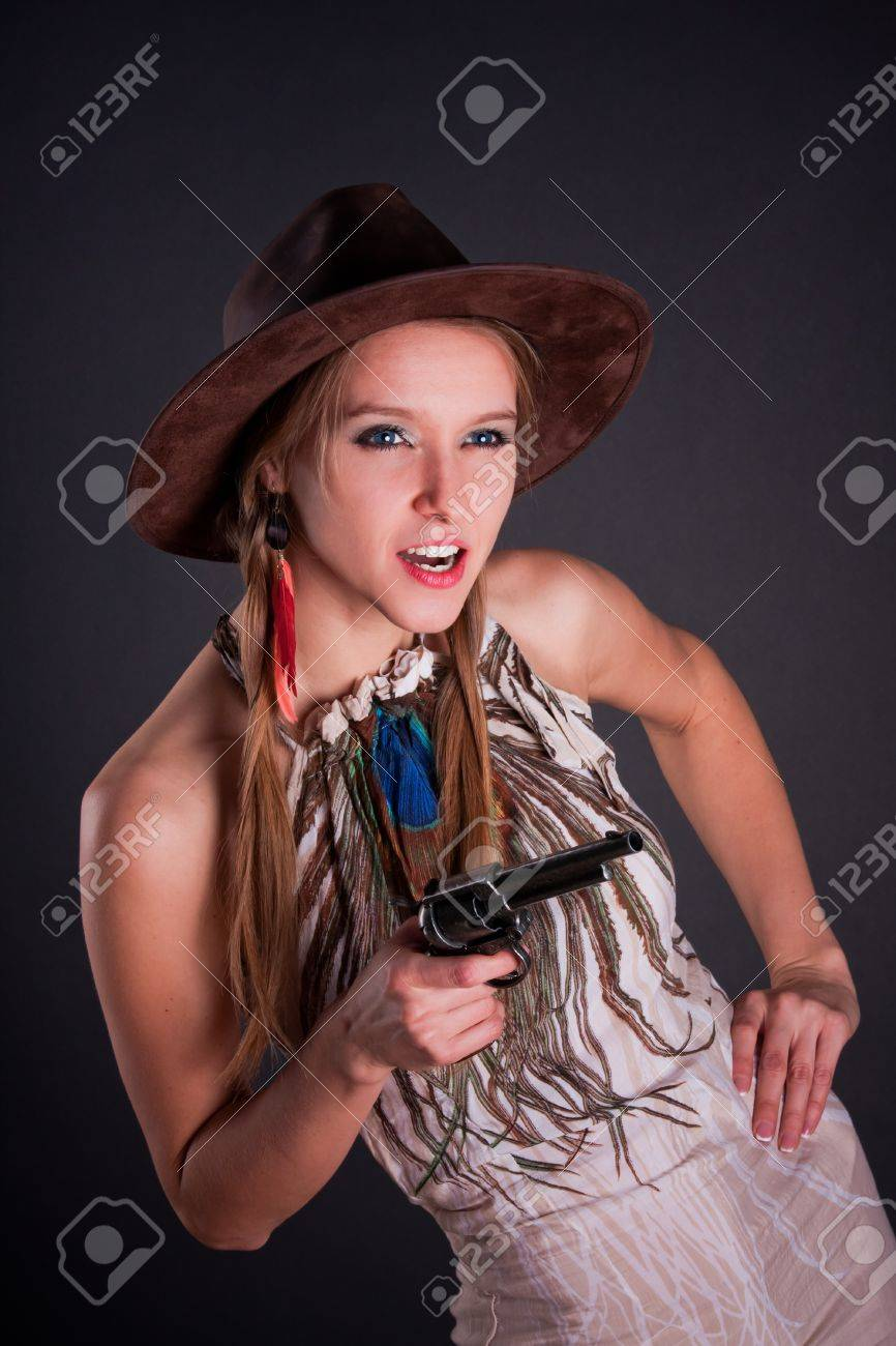 31d1be769f9 ... stock photo the american indian girl in a cowboys hat holds a pistol