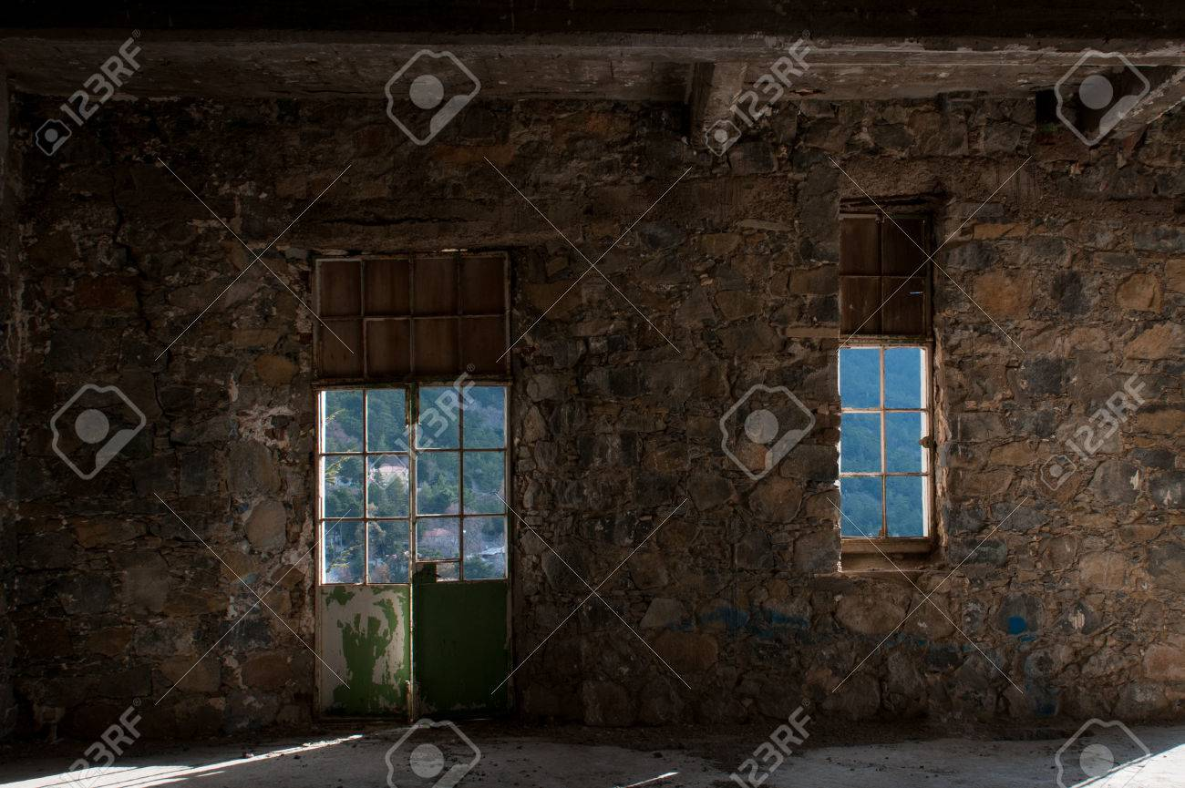 Stock Photo - Window and door on an empty abandoned creepy hotel room with sunrays entering the windows & Window And Door On An Empty Abandoned Creepy Hotel Room With.. Stock ...