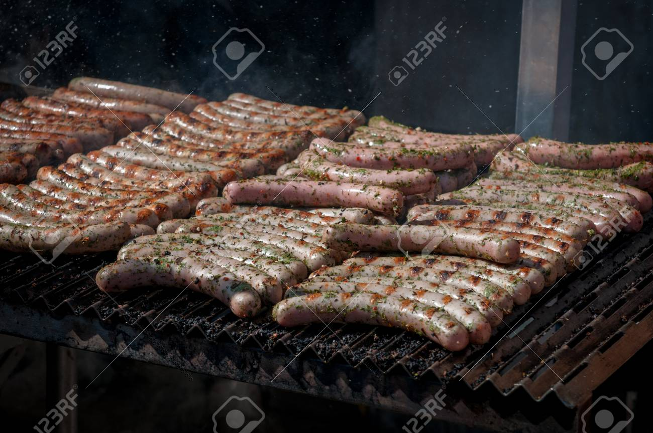 Fresh Frankfurt sausages cooked on barbeque grill