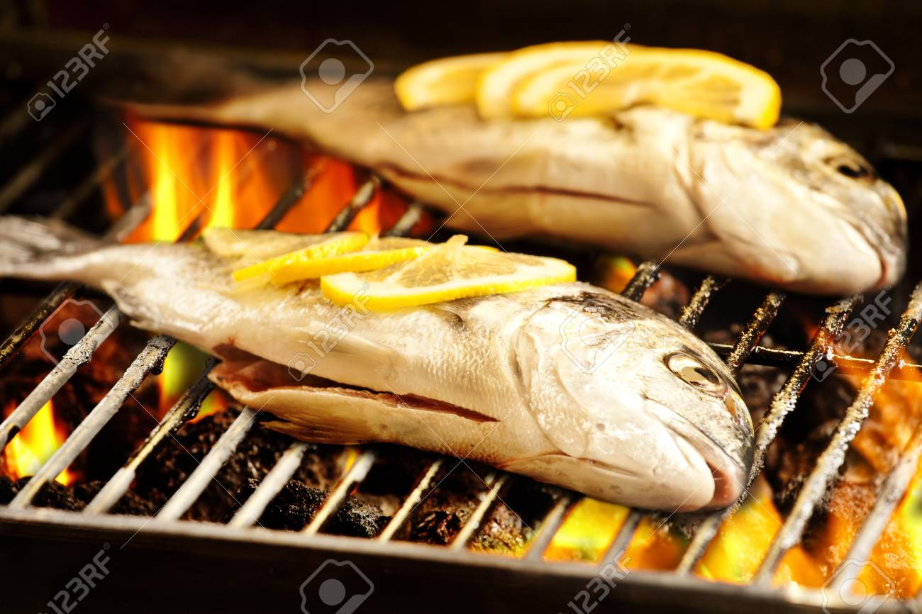 Photograph of two sea breams on the barbecue Stock Photo - 16976840