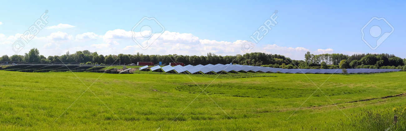 Generating clean energy with solar modules in a big park in northern Europe. - 169911776