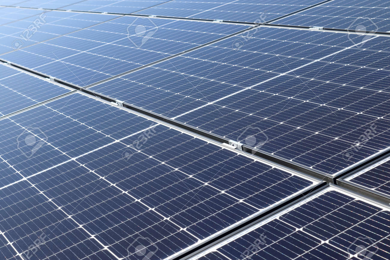 Generating clean energy with solar modules in a big park in northern Europe. - 169911779