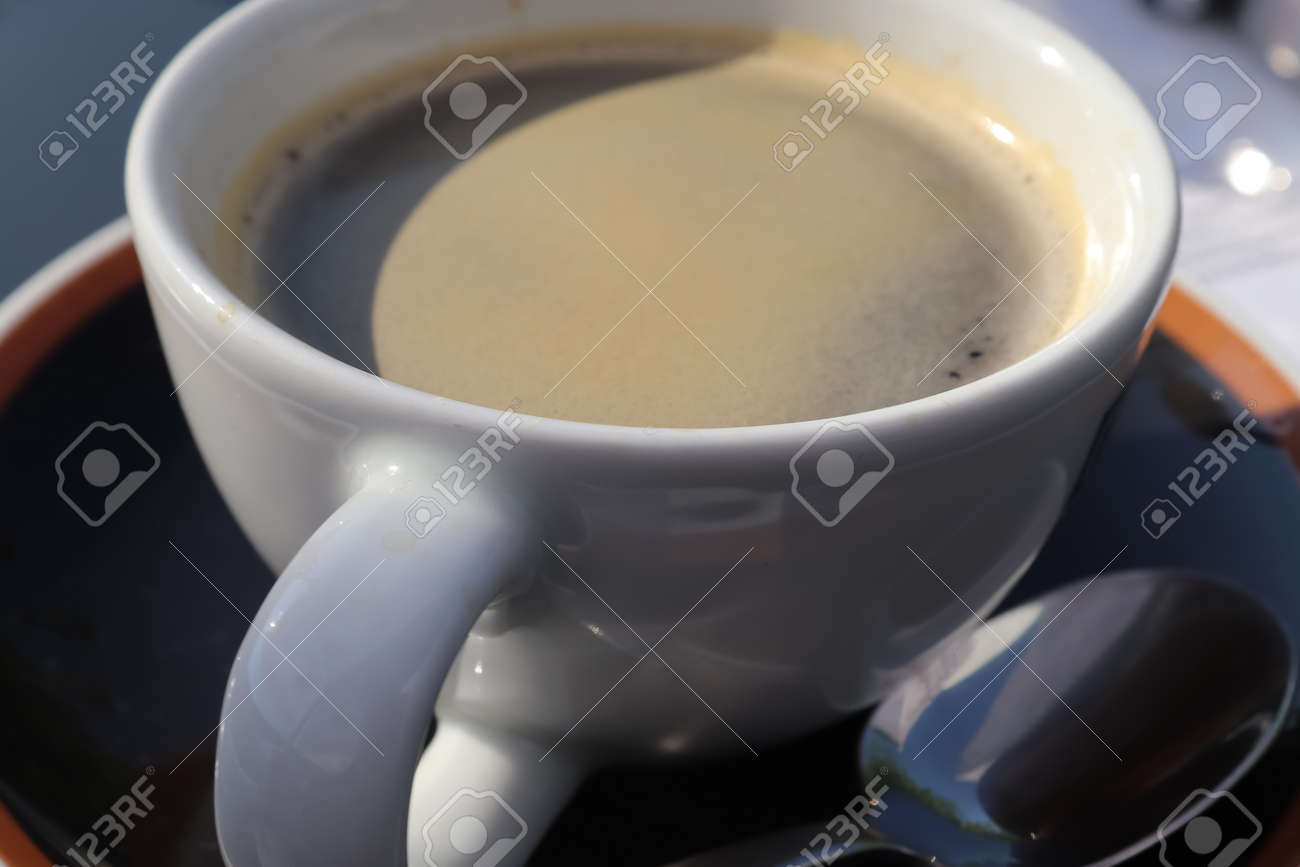Close up view at a coffee surface in a cup. - 169911785