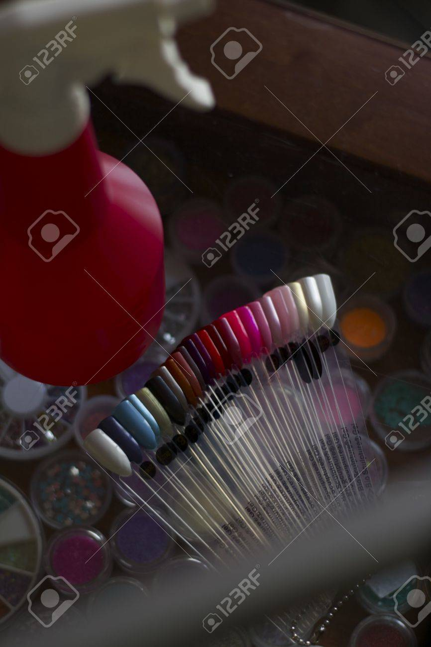 Artificial nail palette and water spray bottle at beauty salon Stock Photo - 13110269