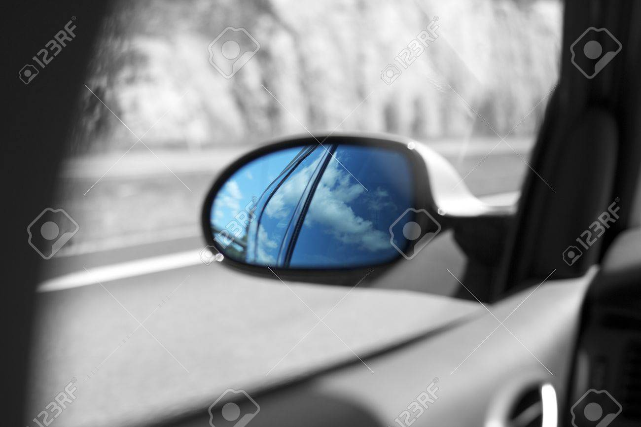 Cars mirror dispaying beautiful blue sky and clouds Stock Photo - 14250042