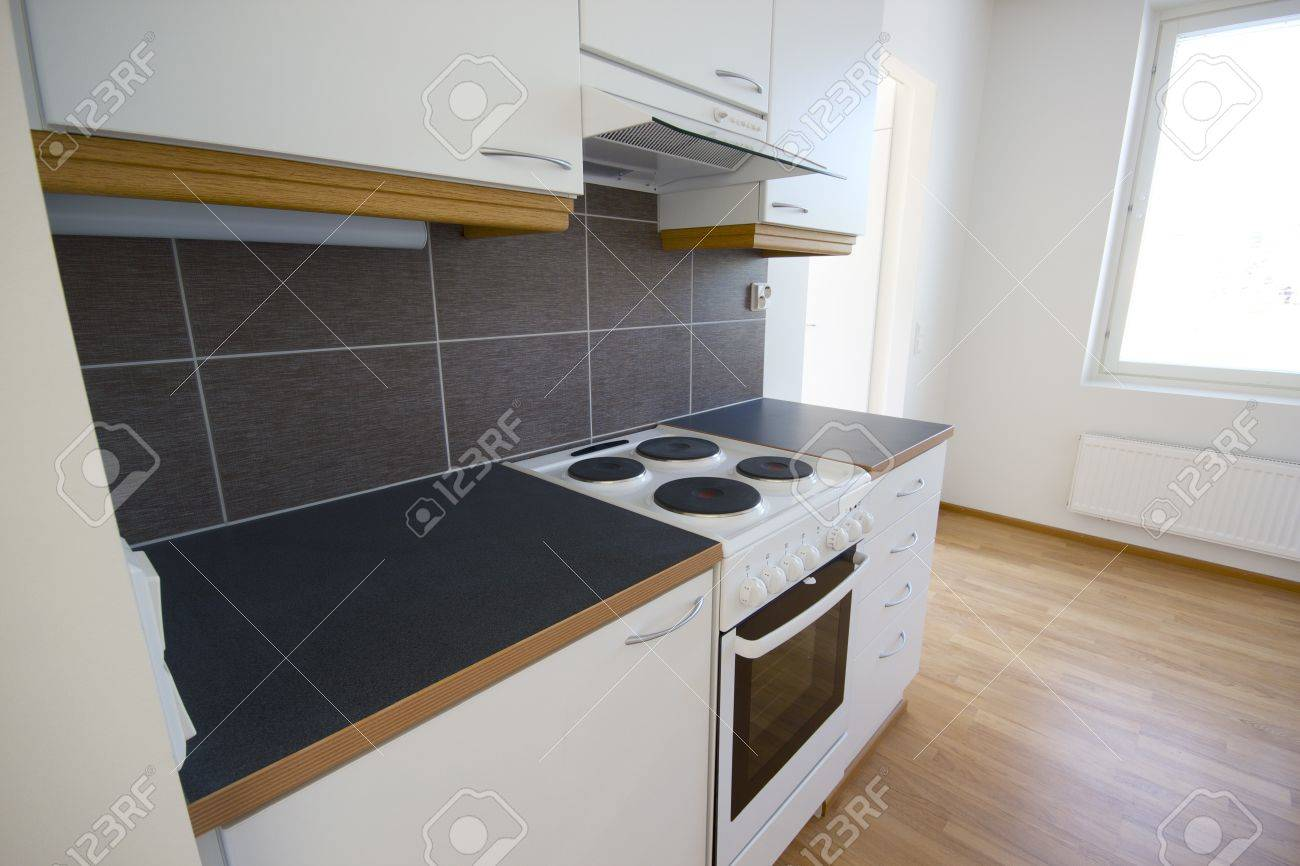 Beautiful empty kitchen in a brand new house Stock Photo - 14413170