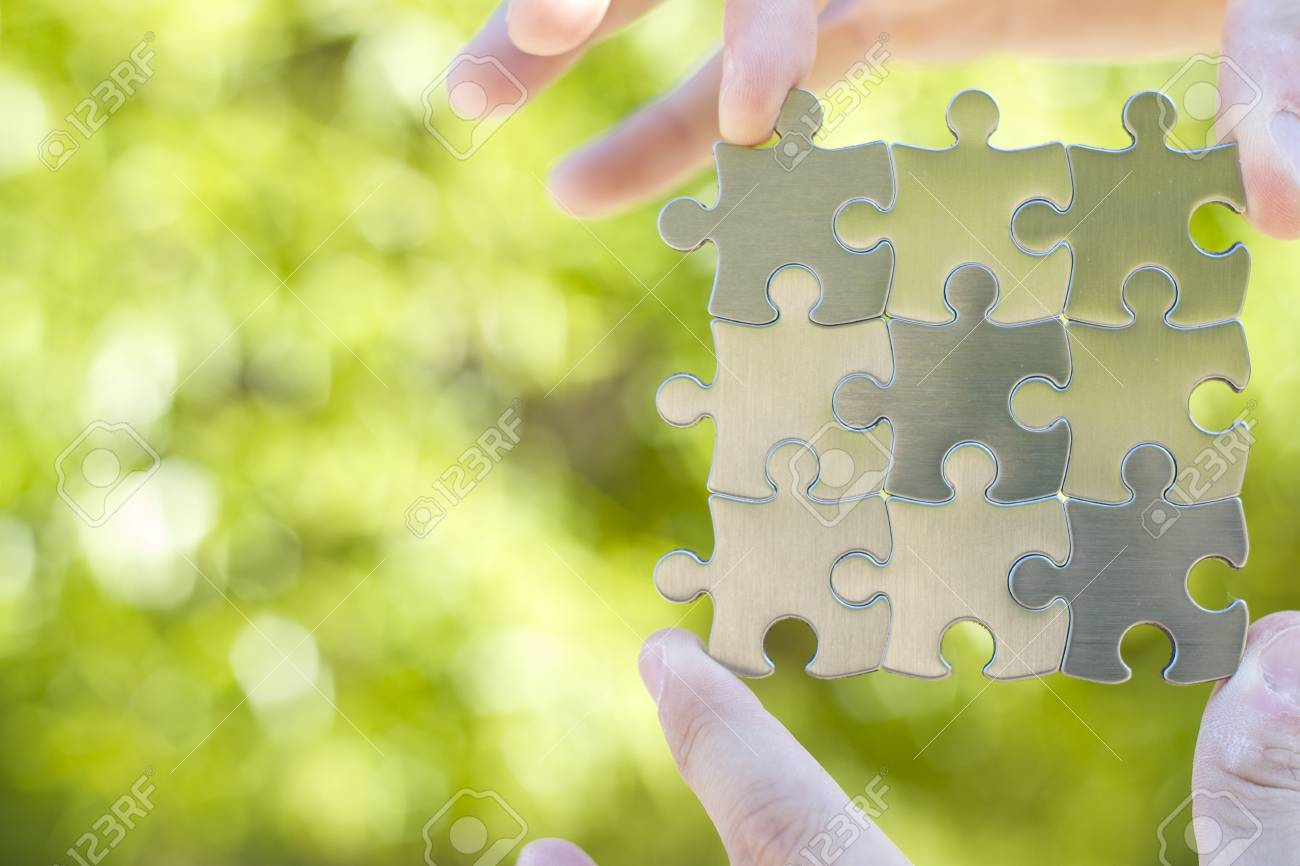 Nine puzzle pieces for business concept in mans hands. Stock Photo - 14414855