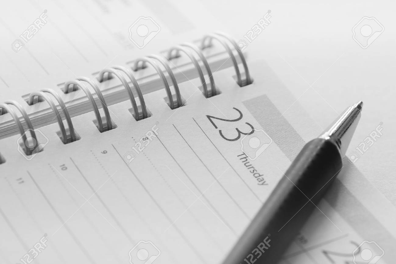 Calendar and pen closeup photi in an office desk Stock Photo - 15183294