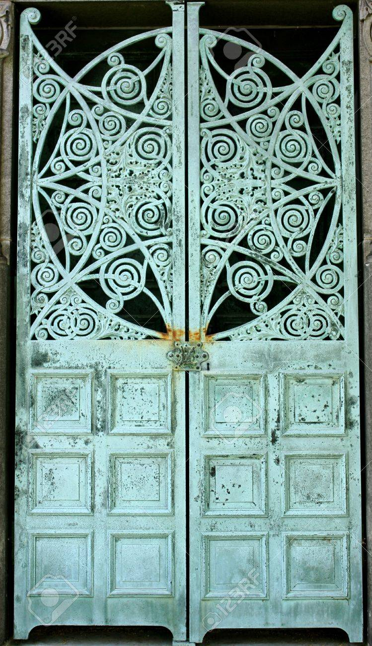 Metal doors aged and weathered to a green patina on a mausoleum at Graceland Cemetery & Metal Doors Aged And Weathered To A Green Patina On A Mausoleum ... Pezcame.Com