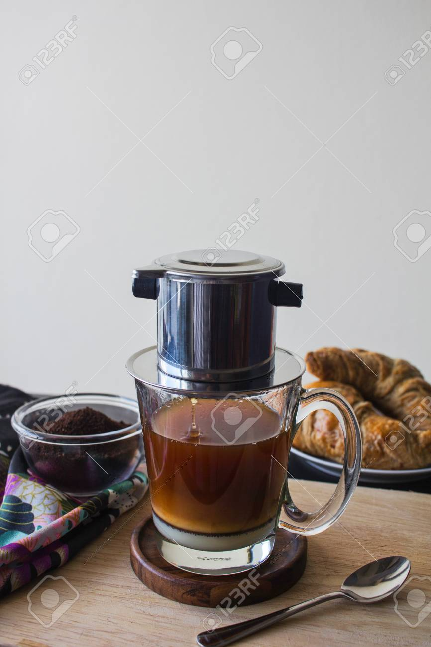 Authentic Vietnamese Coffee Phin Filter Brewing On Wooden Board Stock Photo Picture And Royalty Free Image Image 94361582