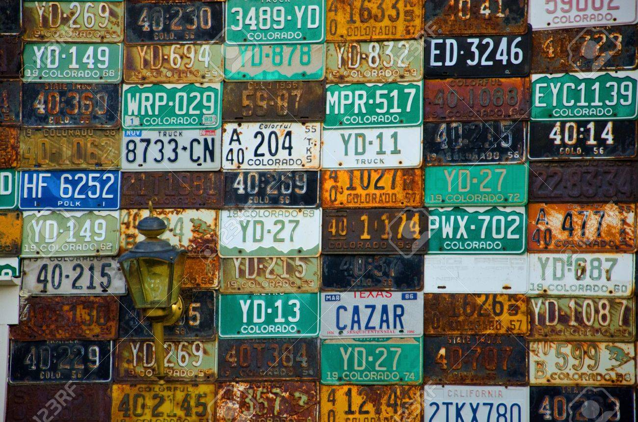 A Unique Wall Of Old Weathered And Rusty Old License Plates From ...