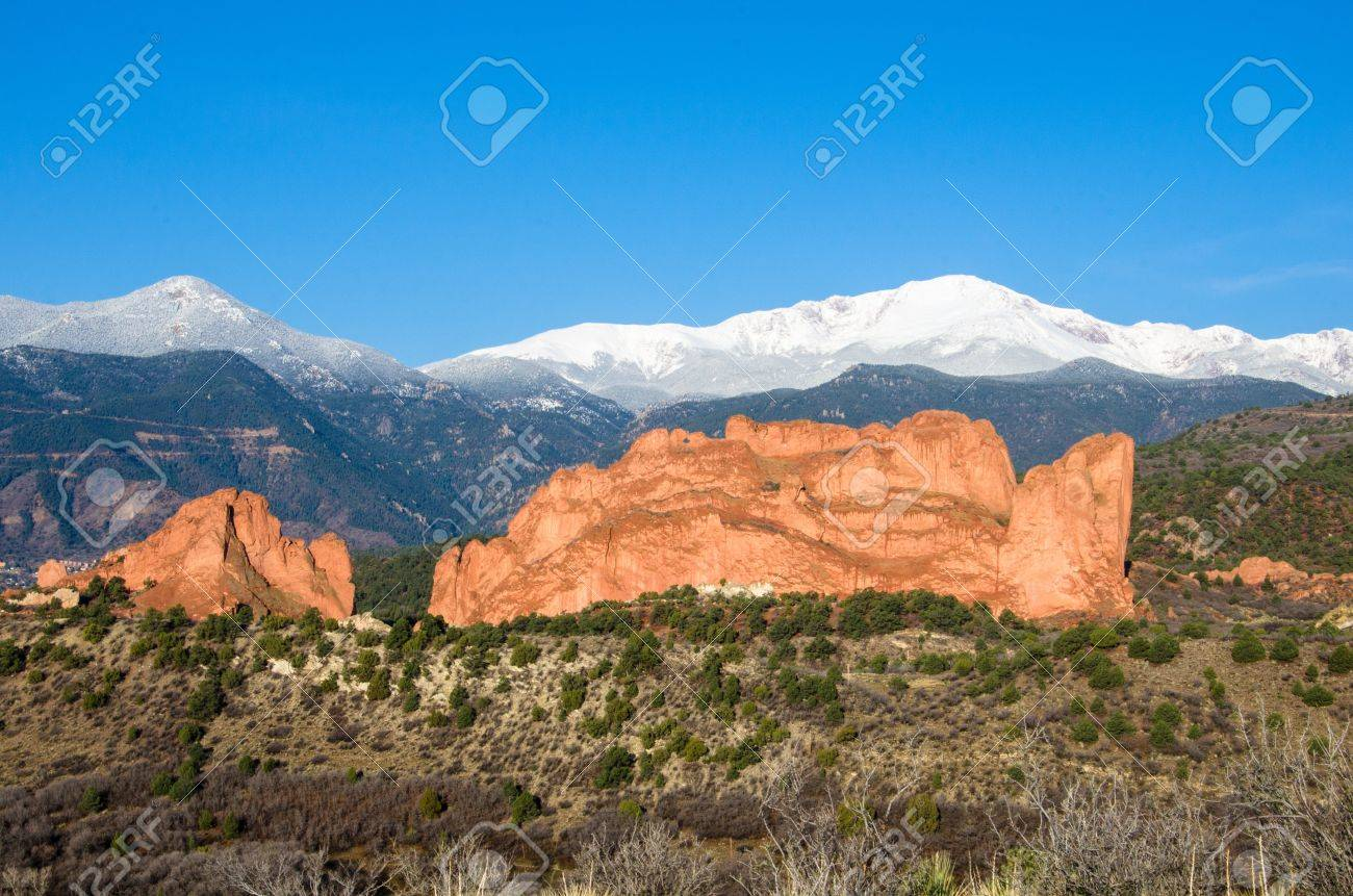 Rainsoaked Kissing Camels, Garden of the Gods, with snow,capped..