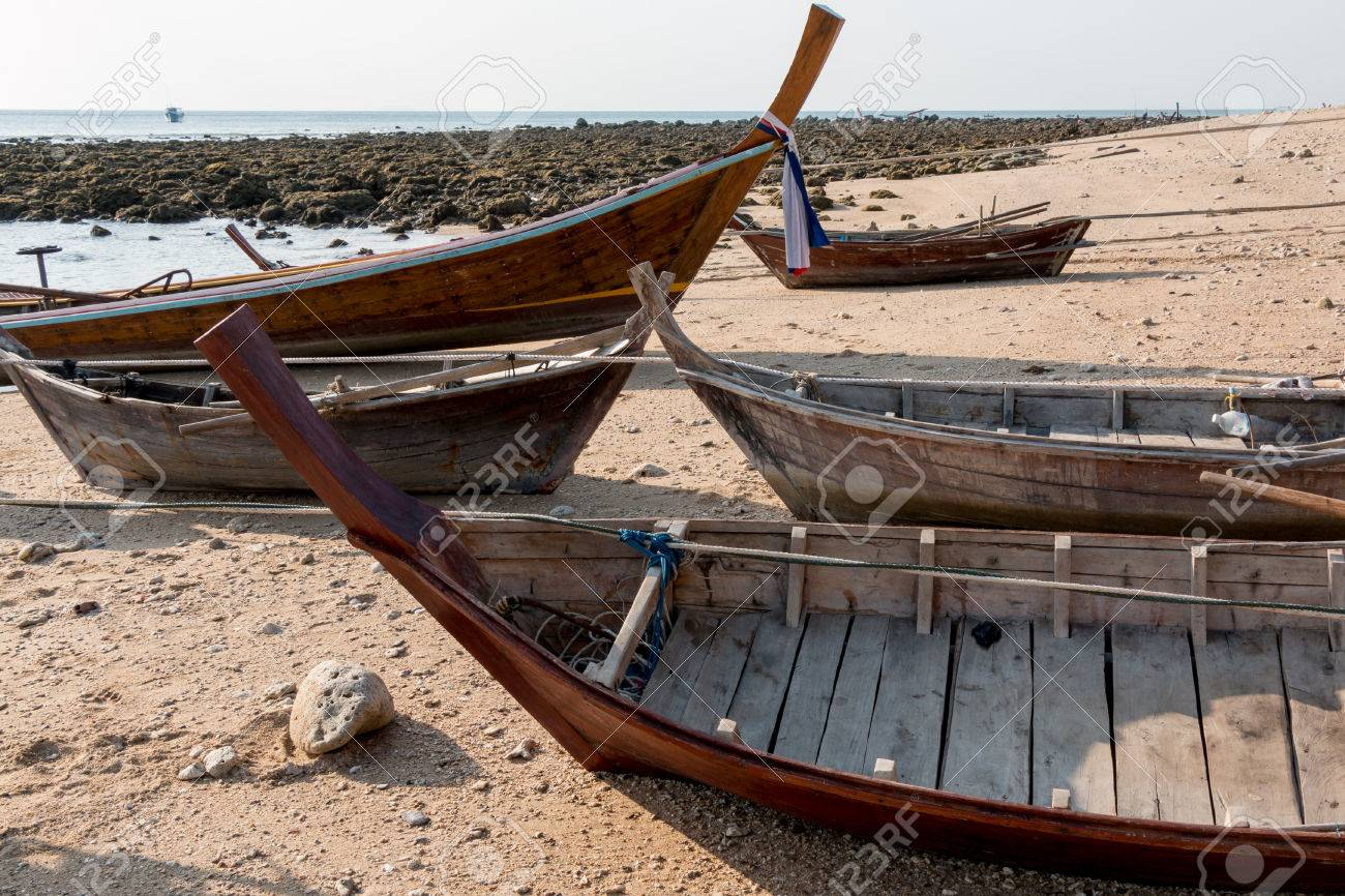 Wooden inside parts of traditional rowing boats at a sunny shore
