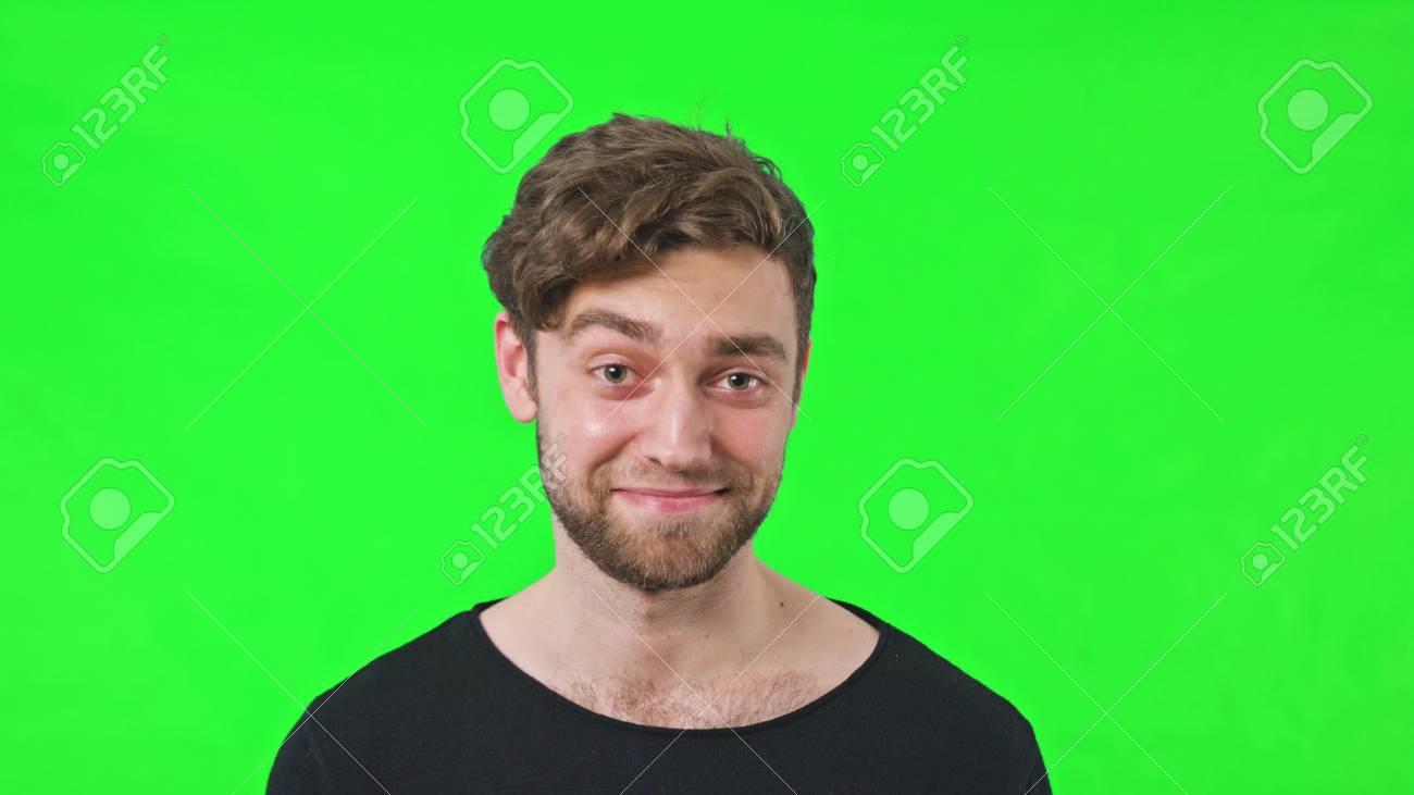slow motion emotion on the man face raise an eyebrow bearded