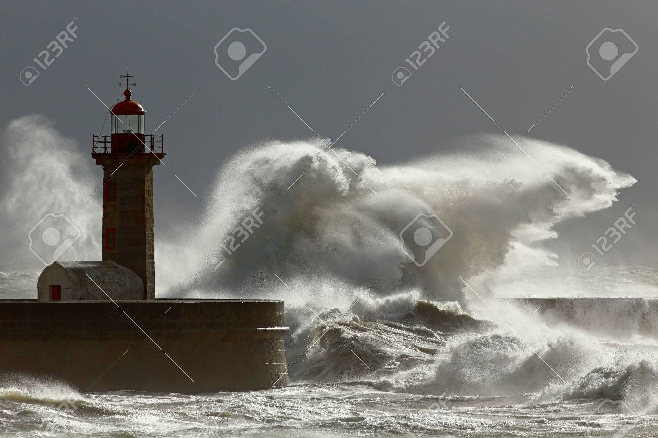 Big stormy waves against lighthouse with interesting light. Porto, Portugal. Low edition photo. - 33678369