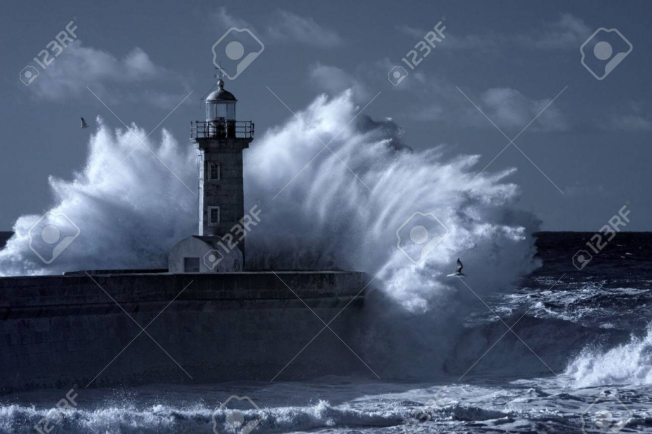 Stormy waves over old lighthouse and pier of the Douro river mouth entry. Used infrared filter. Toned blue. - 51541459