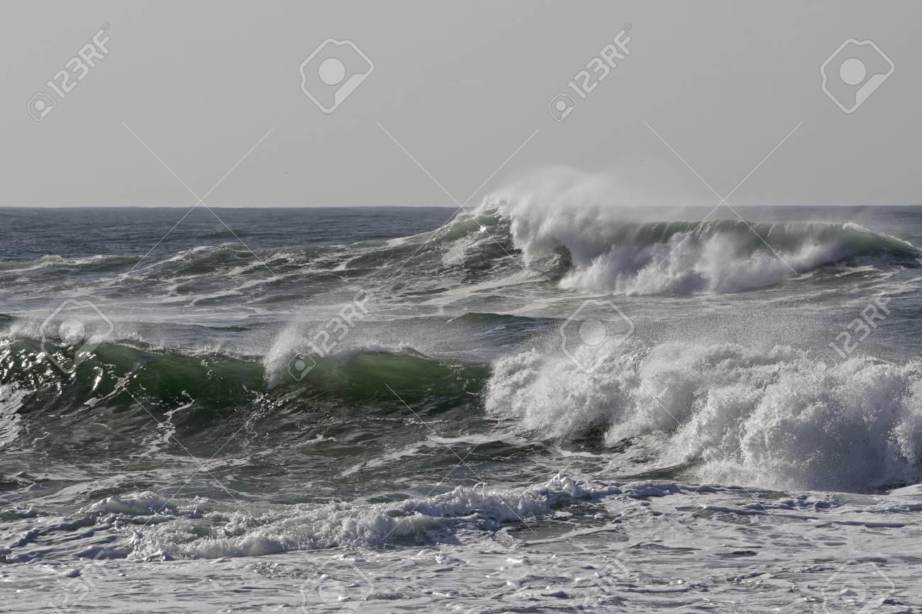 Sunny sea wave with wind spray. Northern portuguese coast. - 119924764