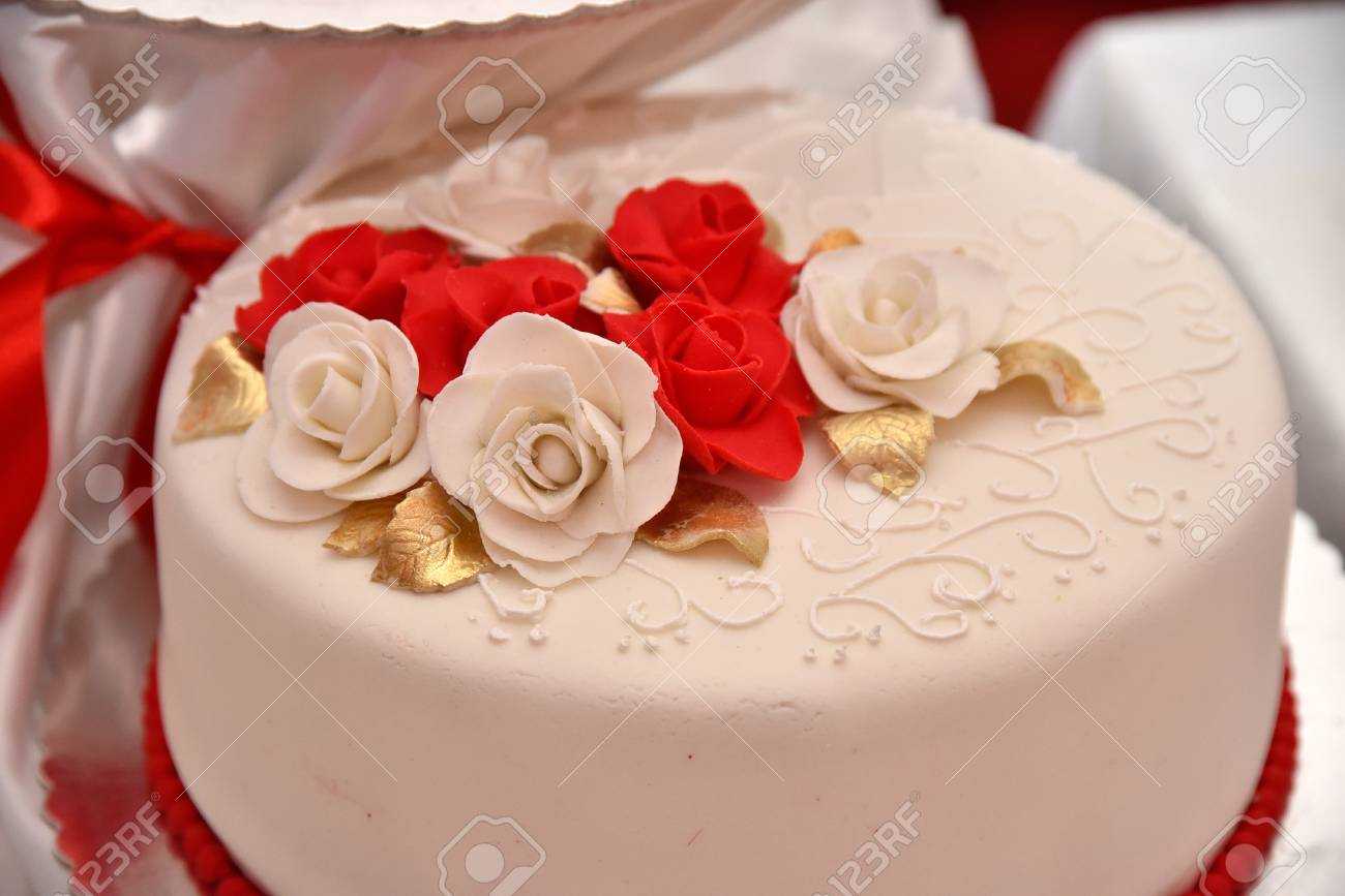 Sweet Cakes In The Form Of Red Roses Decorate The Wedding Cake