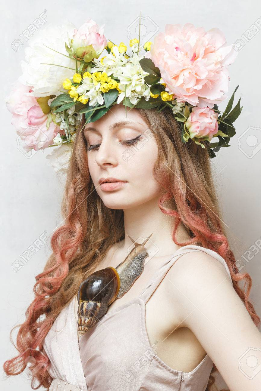 Calm Pretty Girl With Snail And Flower Crown On Head On White