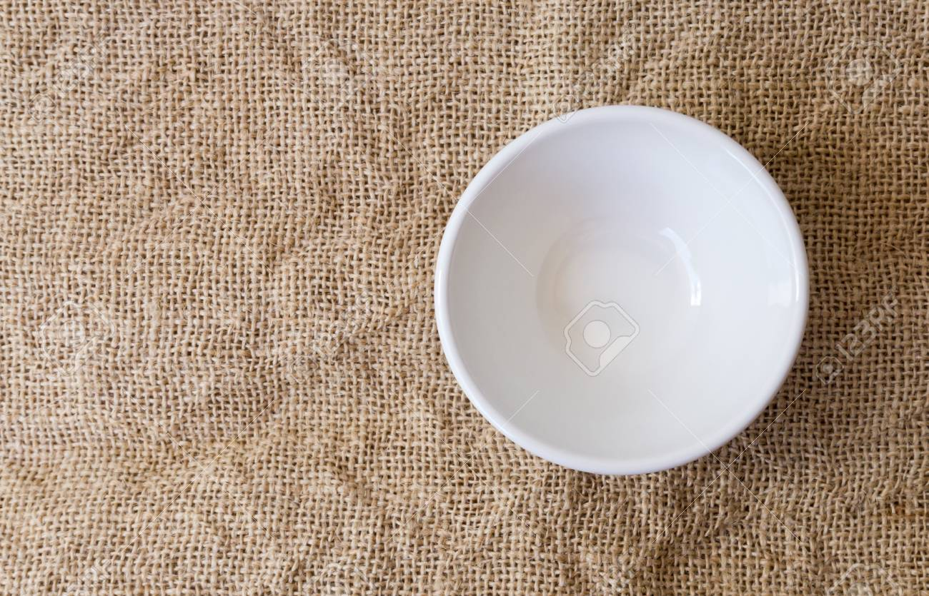 Closeup Top View Empty White Bowl On Sackcloth Background Texture Stock Photo Picture And Royalty Free Image Image 86436904