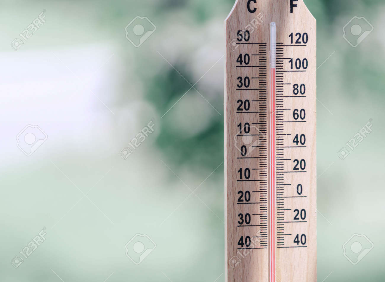 Close up hand holding thermometer with hot temperature - 145072684