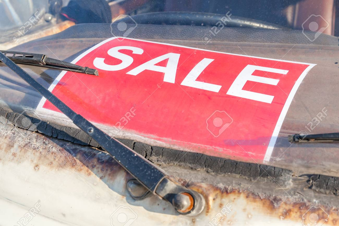 Red Sale Sign Stick On Grungy And Old Used Car Windshield ...