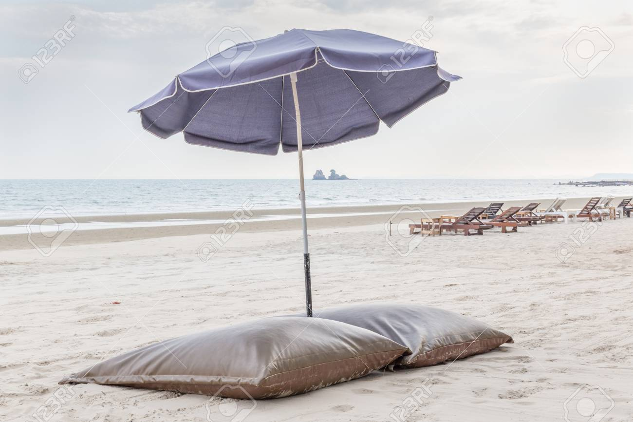 Comfortable beach chairs and umbrella on the white sand beach in evening time relaxation and & Comfortable beach chairs and umbrella on the white sand beach..