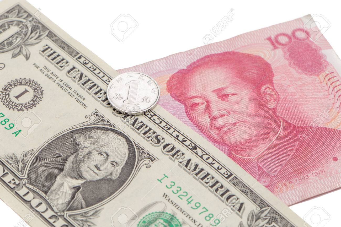 Us Dollar Bill With Chinese Yuan Banknote And Coin On White Background Stock Photo Picture And Royalty Free Image Image 83351443