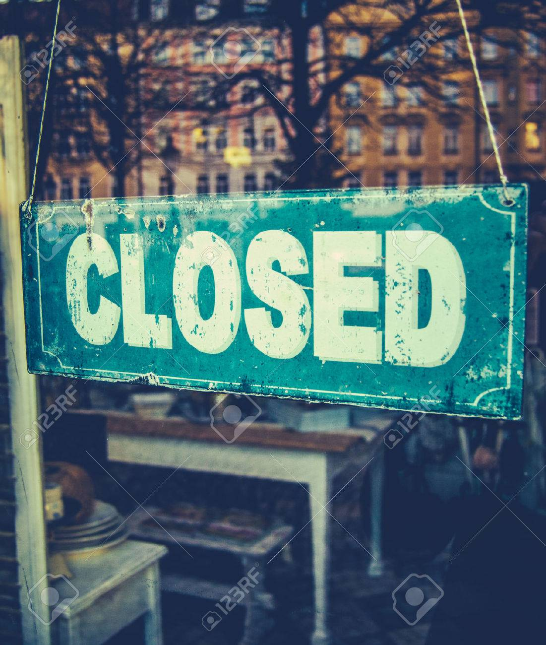 Retail Image Of Grungy Vintage Closed Sign In Furniture Boutique