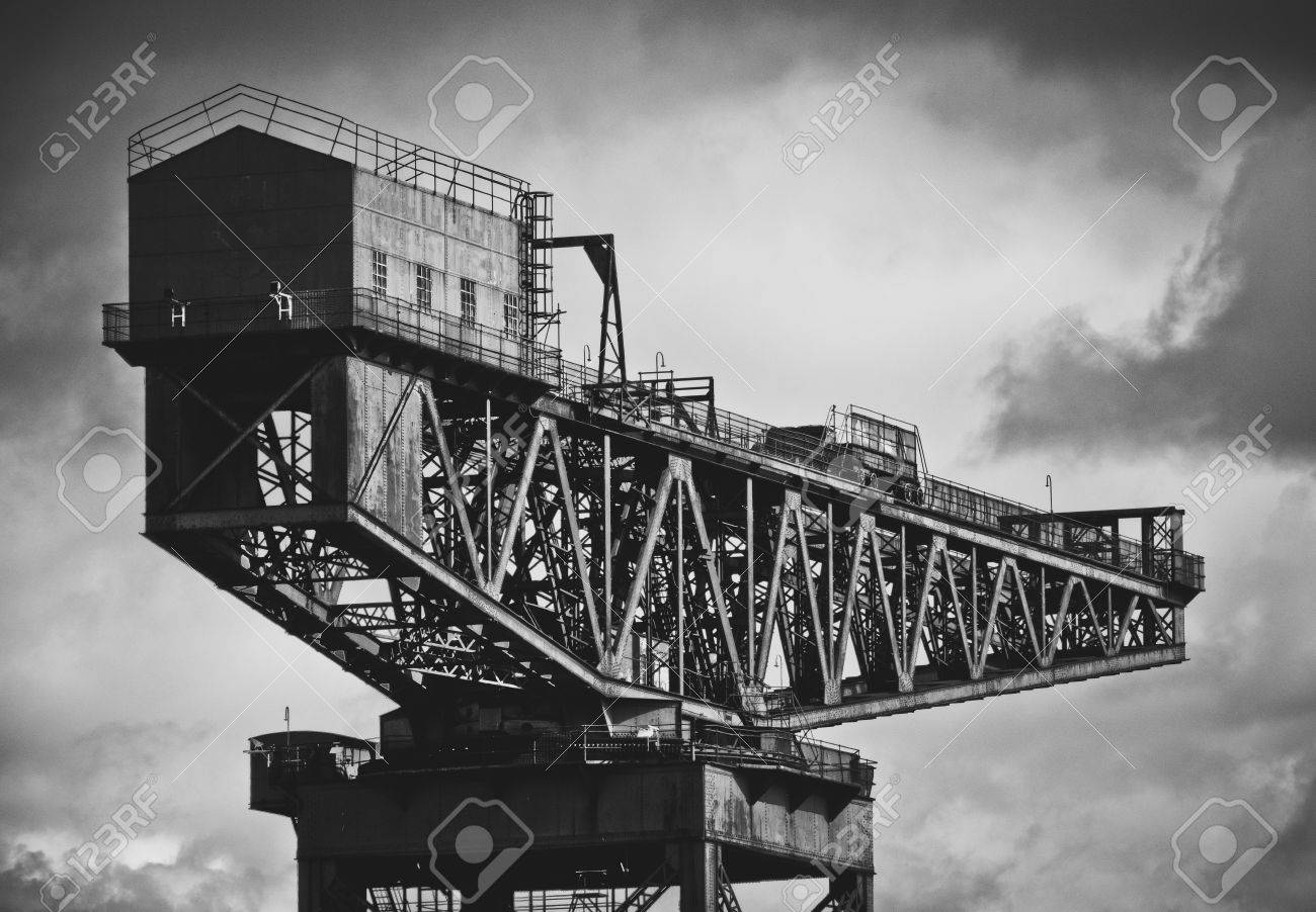 Black and white image of industrial shipbuilding crane on the clyde river in glasgow stock photo