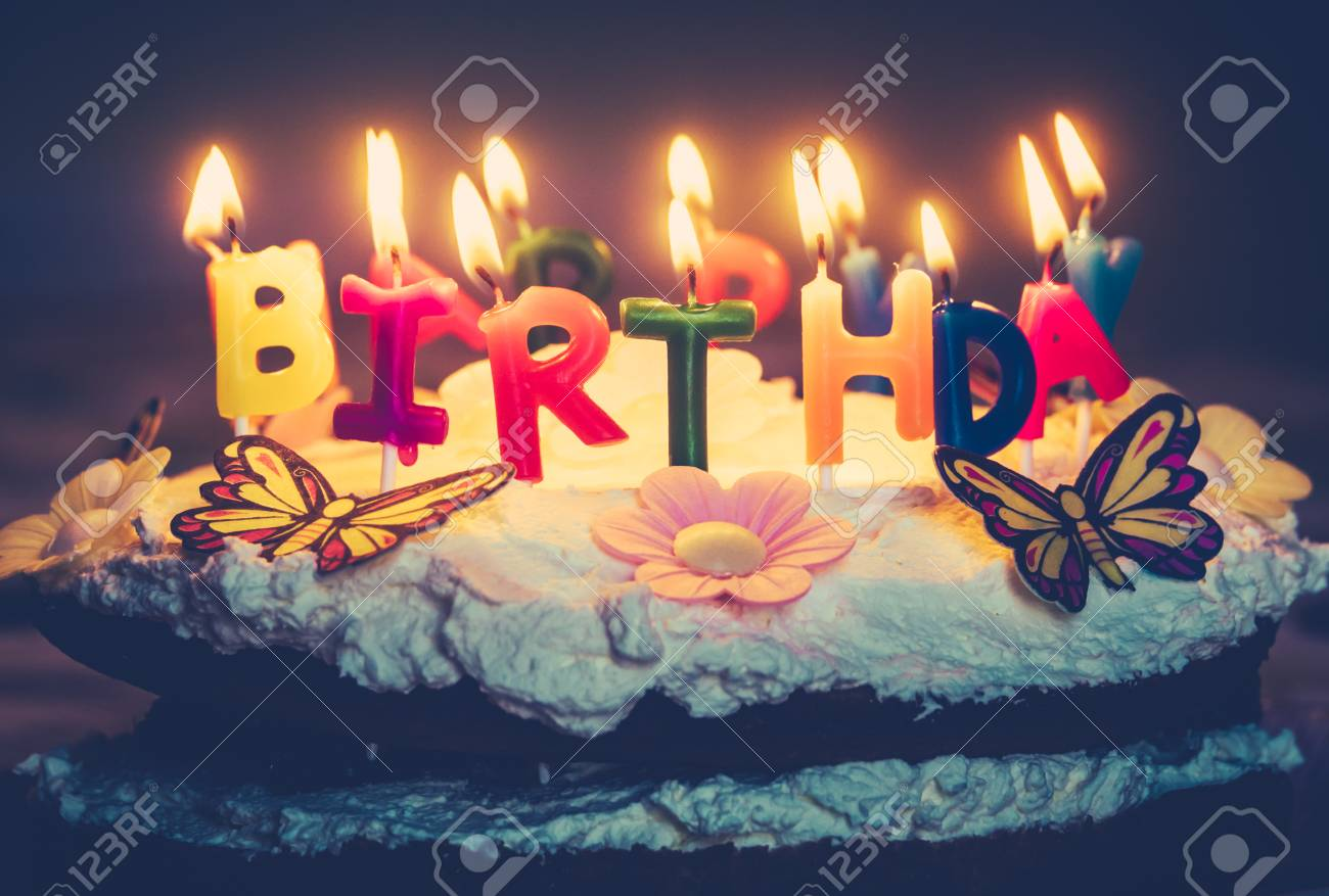 Retro Style Happy Birthday Candles On A Fresh Cream Cake Stock Photo