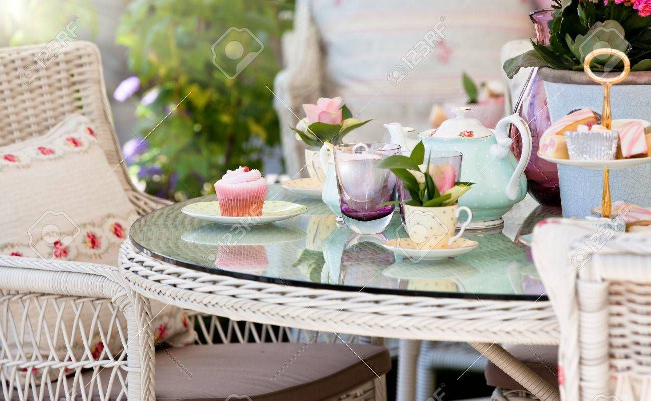 Afternoon tea and cakes in the garden Stock Photo - 14096215