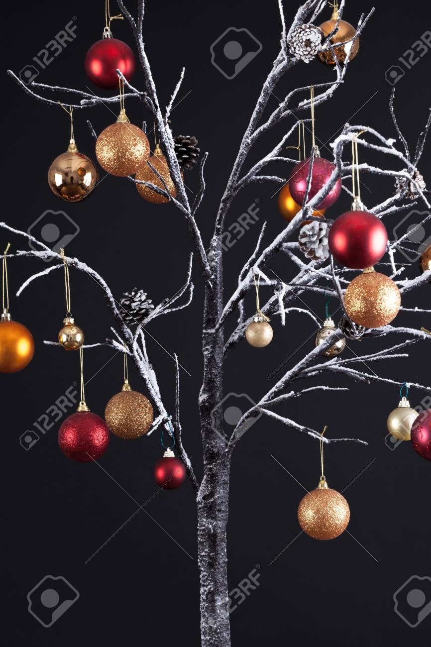 Modern Christmas Trees.Modern Christmas Tree With Bare Snow Covered Branches Decorated