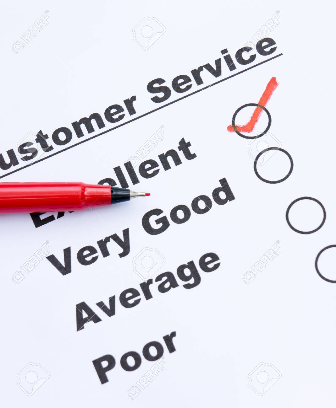 Customer service survey form and pen tick in box Stock Photo - 16674502
