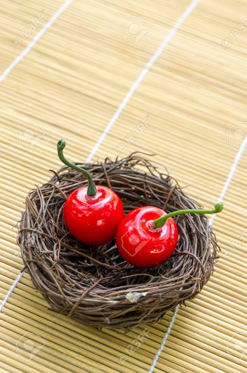 Sweet cherry on nest serve concept Stock Photo - 17946787