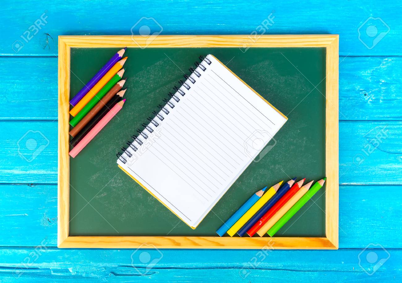 Close Up Arrangement Of Pencil Color, Book And Chalk Board On ...