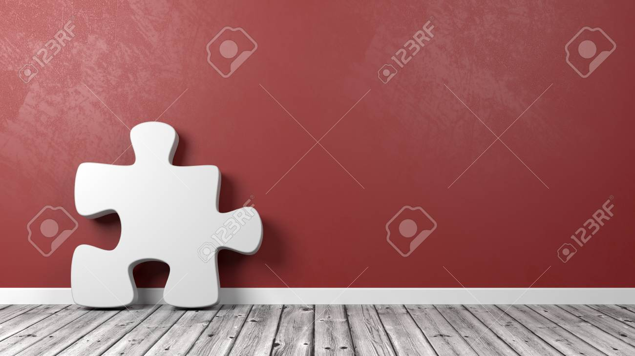 White Puzzle Piece Shape On Wooden Floor Against Red Wall With
