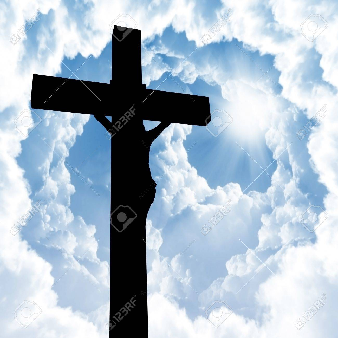 Silhouette of the holy cross on background of storm clouds stock - Wooden Cross Photo Holy Bible And Cross On A Wooden Brown Background