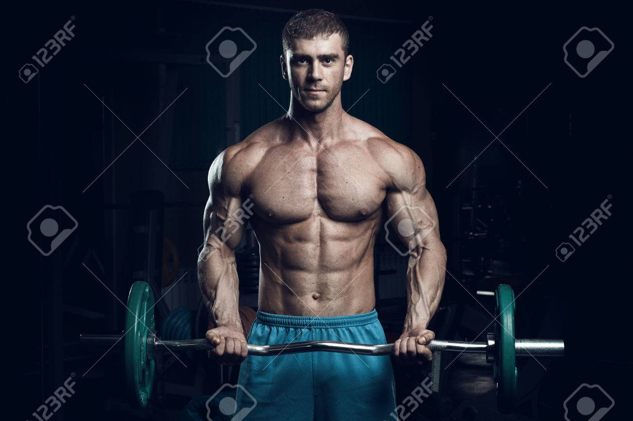Male bodybuilder, fitness model trains in the gym - 61786885