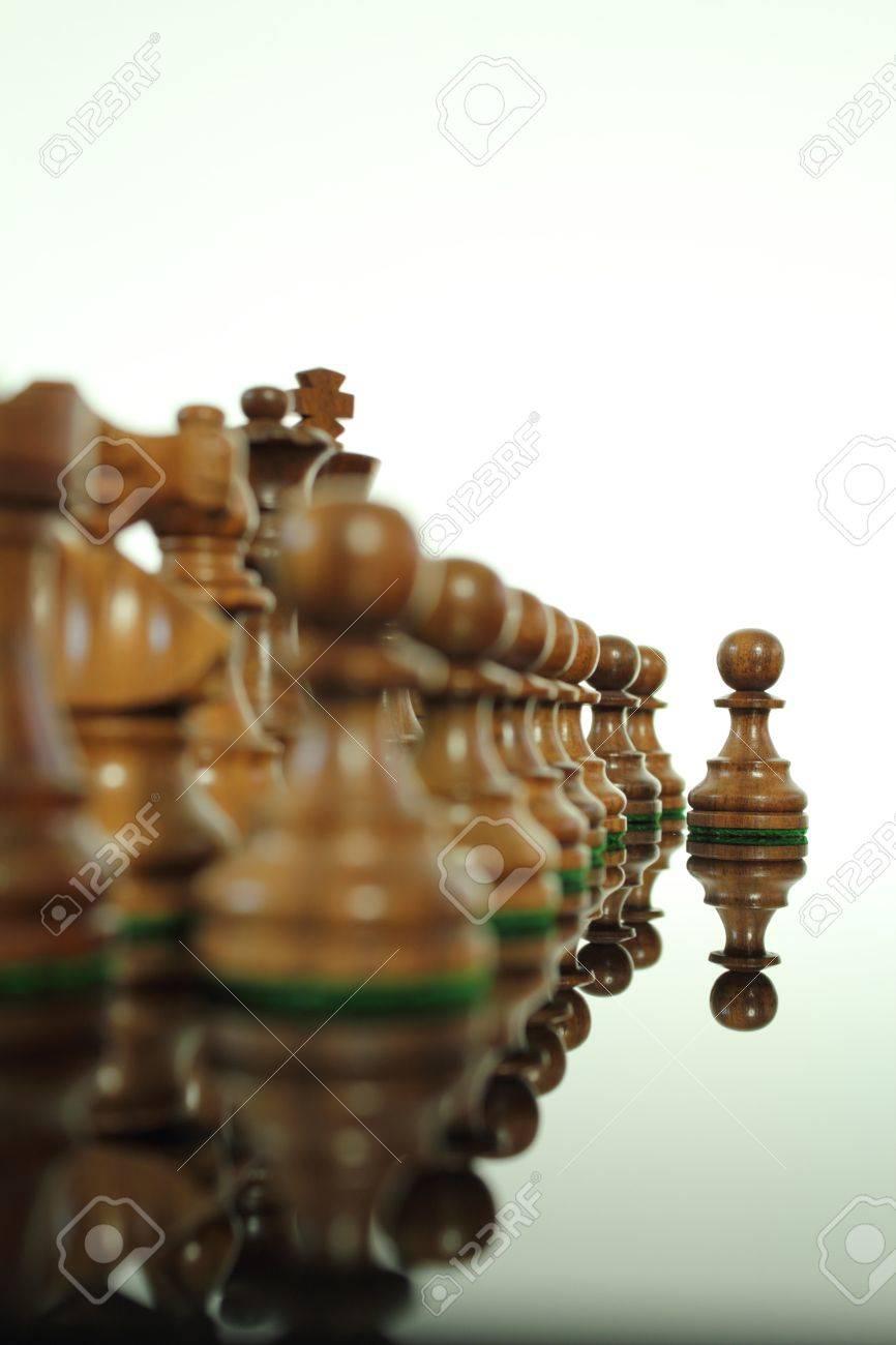 Wood chess pawn beginning move. Stock Photo - 10544708