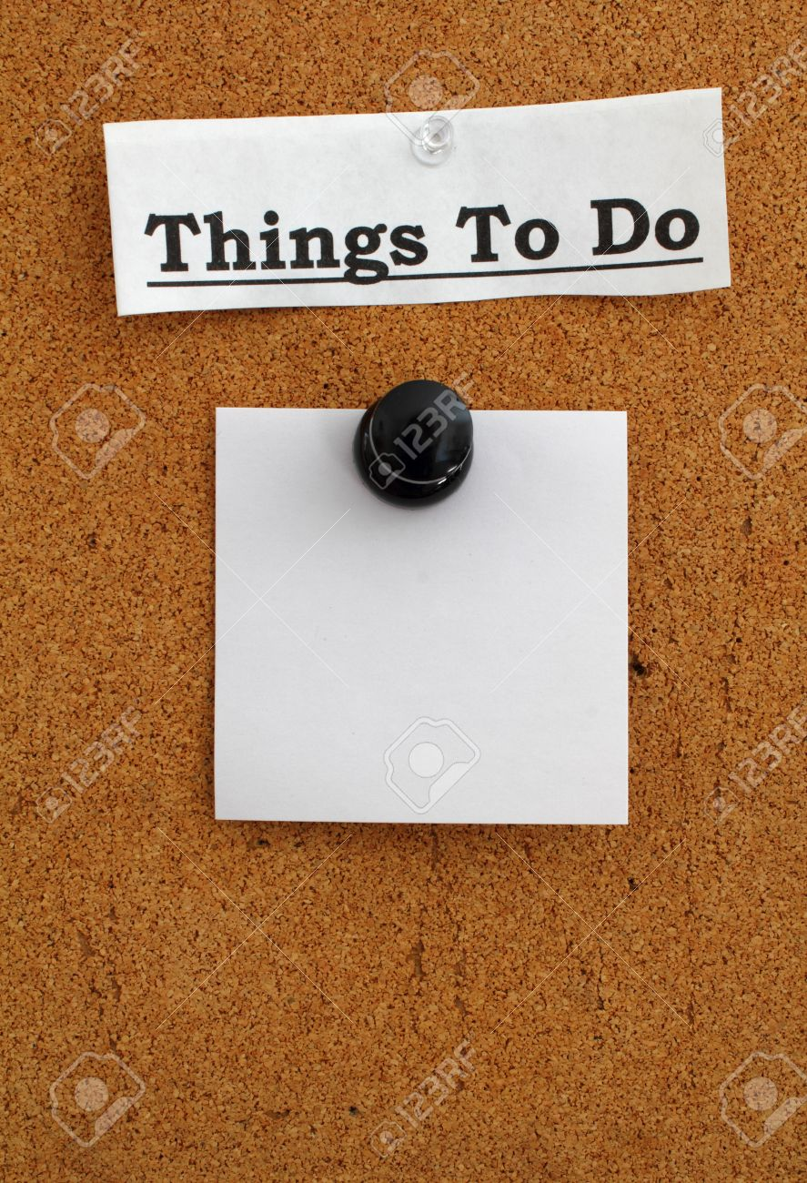 Blank note paper pinned with a giant pushpin to a brown cork board with Things to Do as the heading. Stock Photo - 12363442