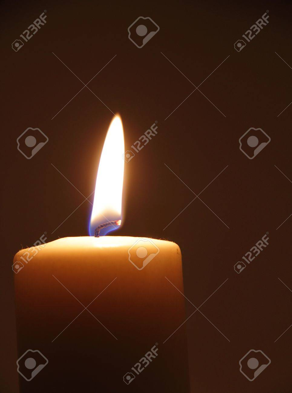 Lone burning candle in the dark Stock Photo - 14127647