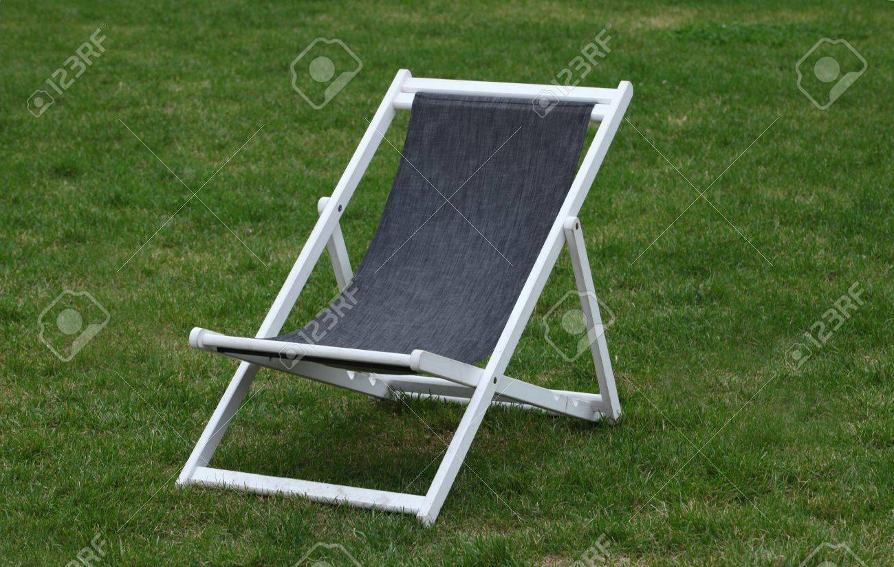 Wooden deck chairs - White Wooden Deck Chair On Green Grass Stock Photo 16101579