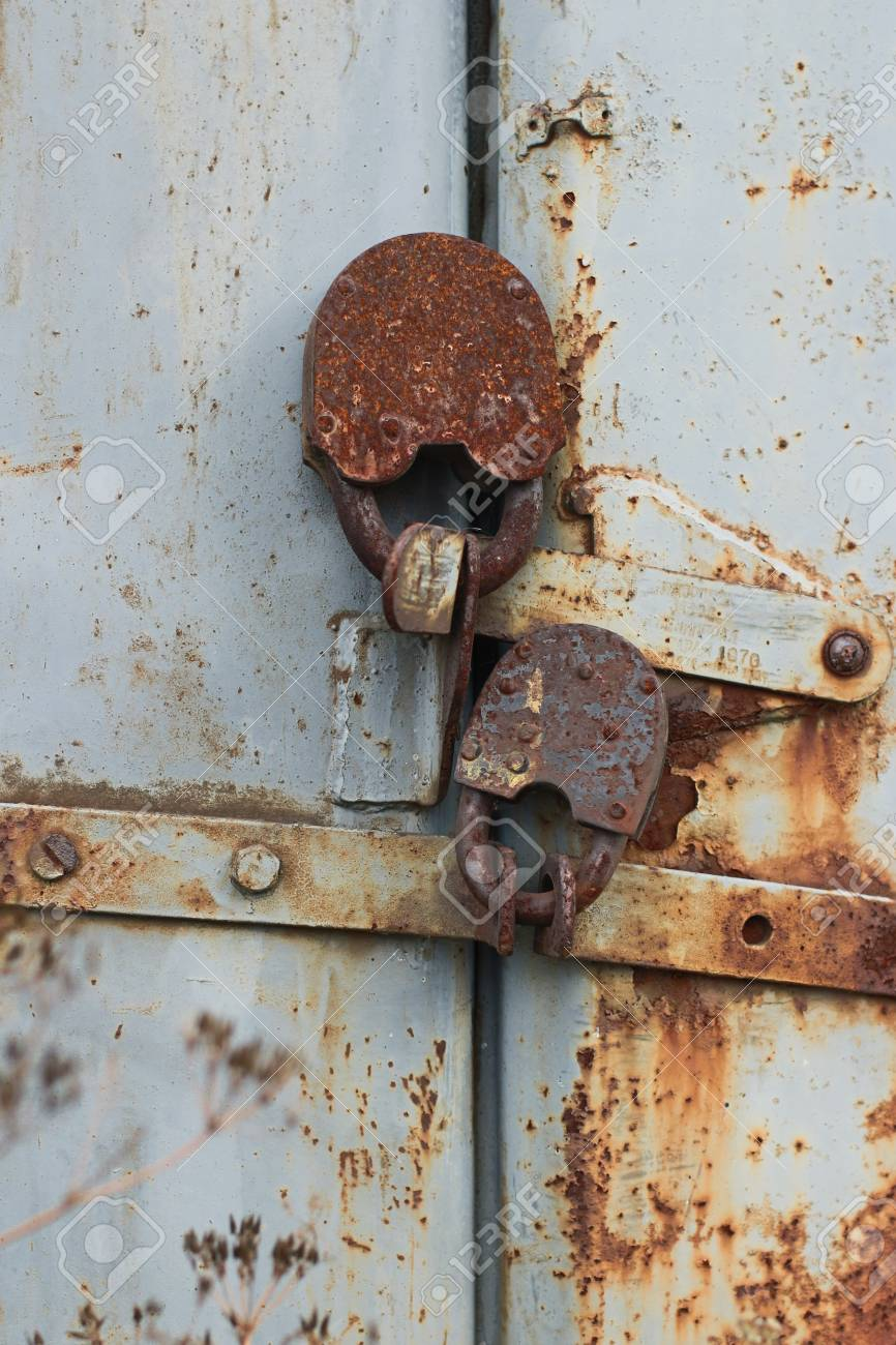 strong old locks rusty hinged barn locks gate locked stock photo