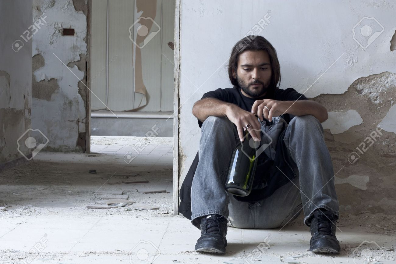 Alcoholic Sitting on the Floor Stock Photo - 7806687