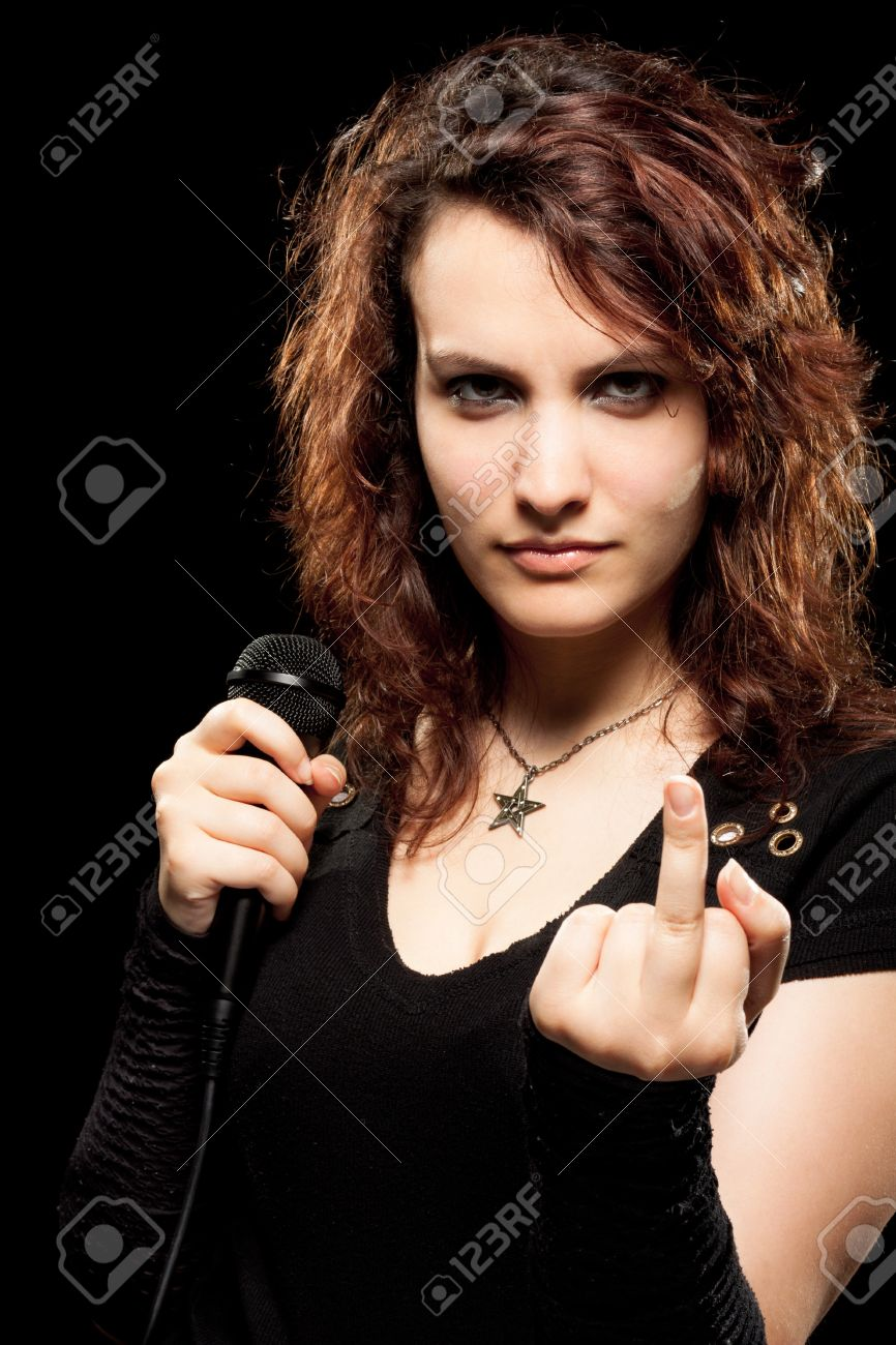 Woman Rock Singer Showing Middle Finger Stock Photo - 9871497